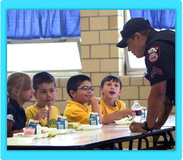 Pueblo SRO talking with children