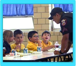 Pueblo SRO talking with children